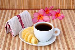 A cup of coffee with banana. And handkerchief Stock Images