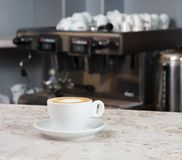 Cup of coffee on the bar Stock Photography