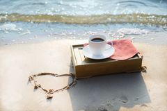 Cup of coffee at the beach Royalty Free Stock Image