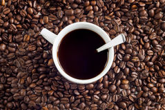 Cup of Coffee. A cup of coffee with coffee bean as background stock photo