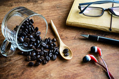 Cup with coffee bean and notebook on old wood Stock Image