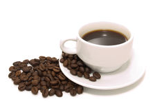 The cup of coffee and beans Royalty Free Stock Photography