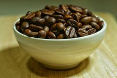 Cup of coffee beans. A cup of coffee beans Royalty Free Stock Image