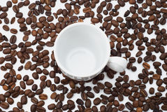 Cup of coffee beans. White coffee cup against the background of coffee beans Stock Photo