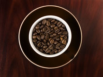 Cup with coffee beans Stock Photo