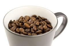 Cup of Coffee Beans. A grey cup filled with whole coffee beans Stock Photos
