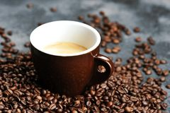 Cup with coffee beans. Cup with coffee and coffee beans royalty free stock images