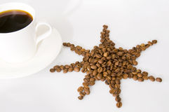 The cup of coffee and beans. Coffee beans isolated on white background Stock Photos