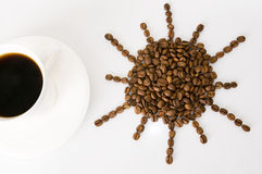 The cup of coffee and beans. Coffee beans isolated on white background Royalty Free Stock Image