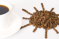 The cup of coffee and beans. Coffee beans isolated on white background Stock Photo