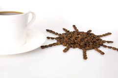 The cup of coffee and beans Stock Photography