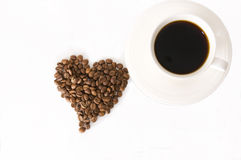 The cup of coffee and beans Stock Photos