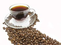 Cup of coffee among beans stock photos