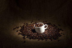 Cup with coffee beans stock photography