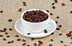 Cup of coffee beans Stock Photos
