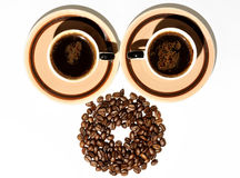 Cup of coffee beans Royalty Free Stock Image
