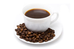 The cup of coffee and beans 2. The cup of coffee and coffee beans scattered around Stock Photography
