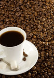 Cup of coffee at beans Stock Images