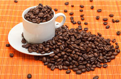 Cup with Coffee Beans Royalty Free Stock Images