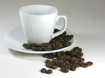 Cup of coffee and beans. Cup of coffee with roasted beans Royalty Free Stock Image