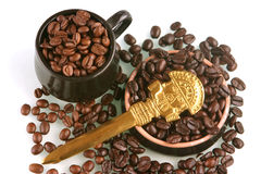 Cup and coffee beans Royalty Free Stock Images