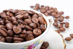 Cup of coffee. With coffee beans Royalty Free Stock Photography