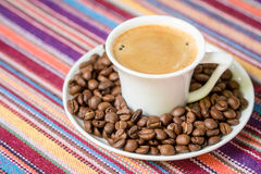 Cup of coffee with  beans Stock Image