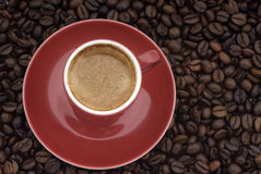 Cup of coffee on beans stock images