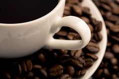 Cup of coffee with beans. Background Stock Photos