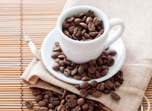 Cup of coffee. Coffee beans Royalty Free Stock Photo