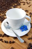 Cup with coffee beans. A shot of a with cup on brown coffee beans Royalty Free Stock Photography