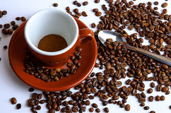 Cup of coffee with beans from above on white background Royalty Free Stock Images
