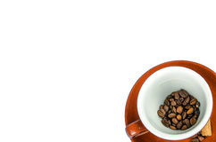 Cup of coffee with beans from above on white background Stock Photography