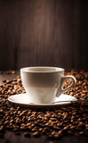 Cup of coffee on beans background Royalty Free Stock Photography