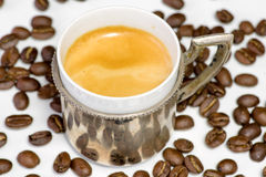 Cup of coffee and beans at backrounds Stock Images