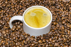 Cup of coffee and beans at backrounds Stock Photography