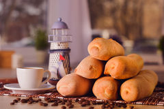 Cup of coffee with beans and baguette Royalty Free Stock Photos