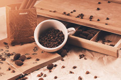 Cup of coffee beans and box with chocolate Royalty Free Stock Photos
