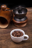 Cup of coffee beans on the brown wooden background Stock Photo