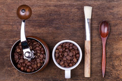 Cup of coffee beans on the brown wooden background Royalty Free Stock Photo