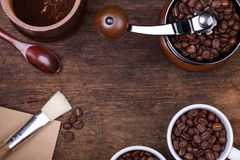 Cup of coffee beans on the brown wooden background Royalty Free Stock Photos