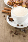 Cup of coffee with beans and cakes on wood Royalty Free Stock Images