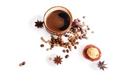 A cup of coffee, coffee beans, candy, anise. Isolate on white. A cup of coffee, coffee beans, candy, star anise. Isolate on white royalty free stock photography