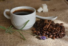 Cup of coffee. And coffee beans on canvas Royalty Free Stock Photography