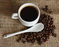 Cup of coffee. And coffee beans on canvas Royalty Free Stock Image