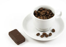 Cup with coffee beans and chocolate isolated Stock Image