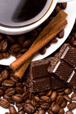 Cup of coffee, beans, cinnamon Stock Images