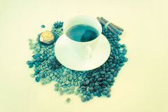 Cup coffee, beans , cinnamon, star anice, sweet, copy space. Blue vanilla. White cup coffee, beans , cinnamon, star anice, gold sweet. Blue vanilla stock image