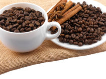 Cup with coffee beans and cinnamon Royalty Free Stock Image