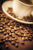 Cup Of Coffee and Beans Close-up Stock Images